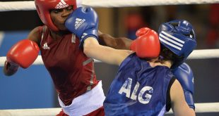 Nigeria's Caroline Linus (L) and Algeria's Souhila Bouchene compete in the women's boxing (48-51kg) final at the 11th Africa Games in Brazzaville on September 12, 2015. AFP PHOTO / MONIRUL BHUIYAN        (Photo credit should read Monirul Bhuiyan/AFP/Getty Images)