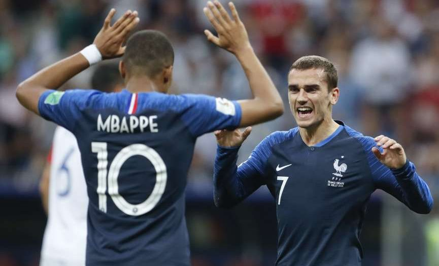 France's Antoine Griezmann celebrates with his teammate Kylian Mbappe, left, after Paul Pogba scored his side's 3rd goal, during the final match between France and Croatia at the 2018 soccer World Cup in the Luzhniki Stadium in Moscow, Russia, Sunday, July 15, 2018. (AP Photo/Petr David Josek)/FP199/18196589735894/1807151830