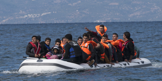 Skala Sikamineas, Lesbos, Greece - October 25, 2015: An inflatable boat filled with refugees and other migrants approaches the north coast of the Greek island of Lesbos. Turkey is visible in the background. More than 500,000 migrants have crossed from Turkey to the Greek islands so far in 2015.